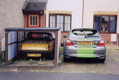 When we didnt have room for a garage, Sean put his thinking cap on and this kept the Midget dry for a good few years!!