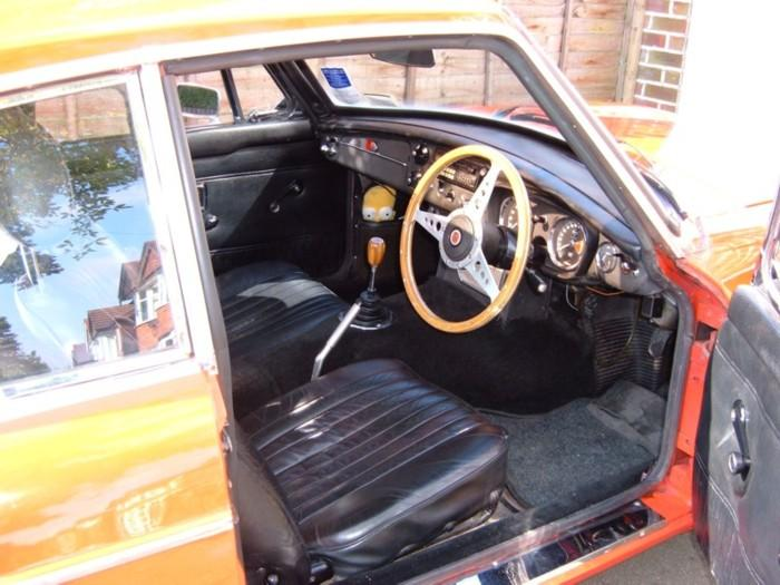 My 1970 MGB GT. Leather seats, a wooden steering wheel and gearknob, but otherwise fairly standard. Don't mind Homer, he's good for clearing the windscreen when it mists up!For more pics see my website, which is linked from the links page.
