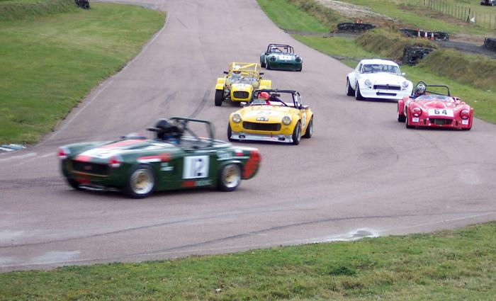 Paul Bearnal Ryan (yellow car) of the Vintage and Sportscar Garage, Harrietsham winning his class in the SEMSEC Championship at Lydden last year.