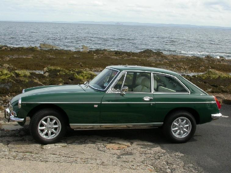 My MGB GT down by the river Forth in the Kingdom of Fife.