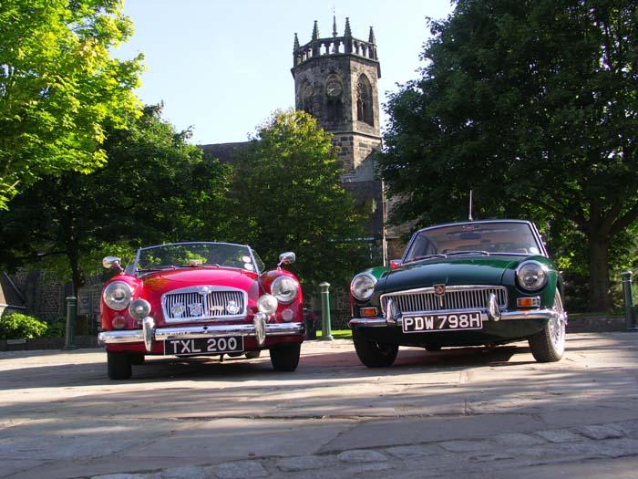 Early morning shot of a 1957 MGA and 1969 MGB in front of ST Mary's church