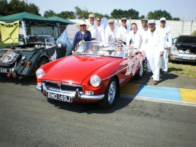 Some dashing mechanics, assisting the Ladies at Le Mans