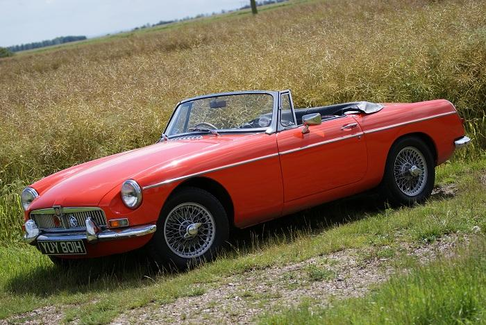 My 1969 MGB, Blaze red (hence the pun), basking in the sun.  Taken in the summer-time, around July, I remember the day was sublime.  BLAST!! I'm talking in rhyme!